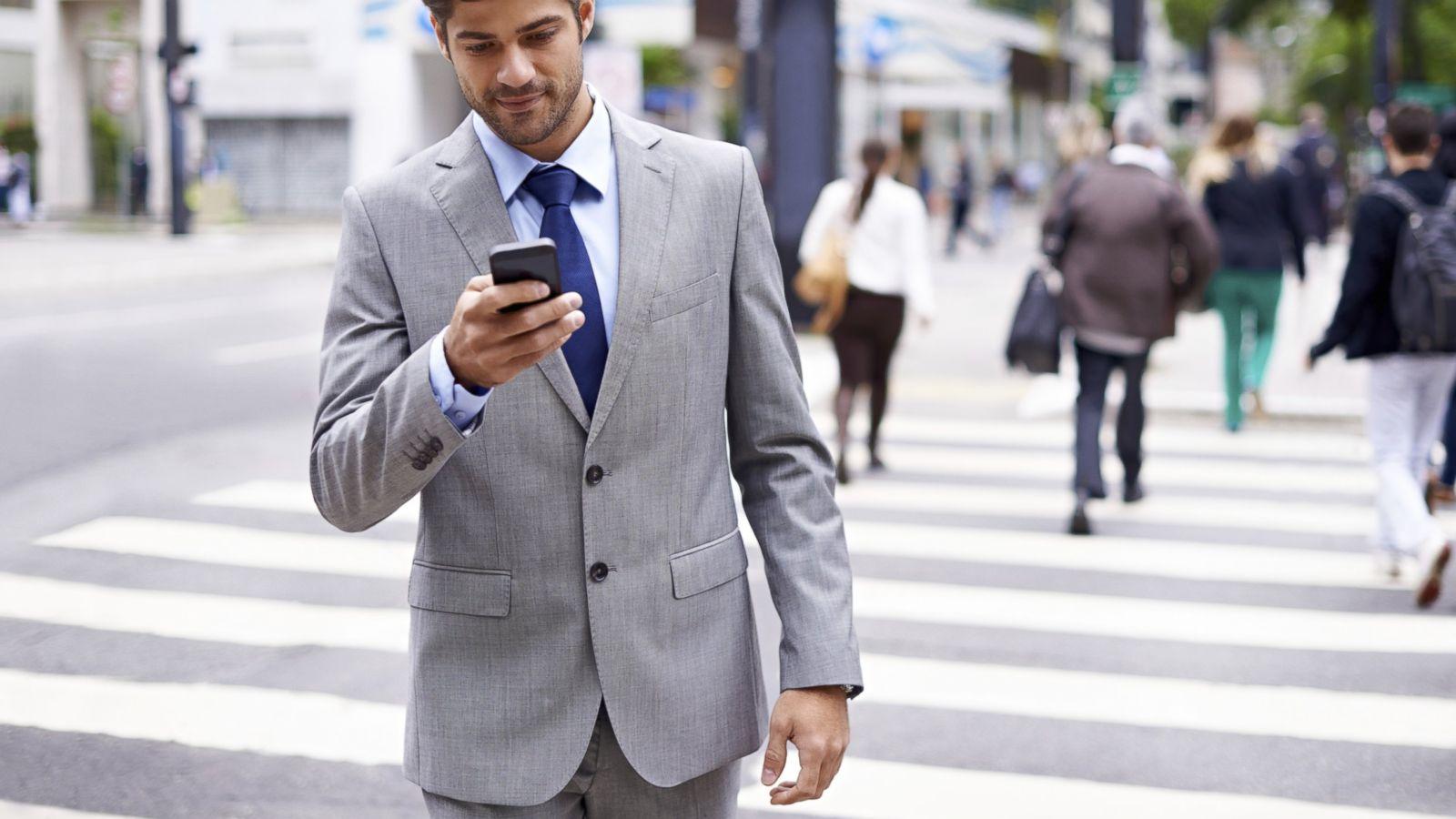 Man on phone on street